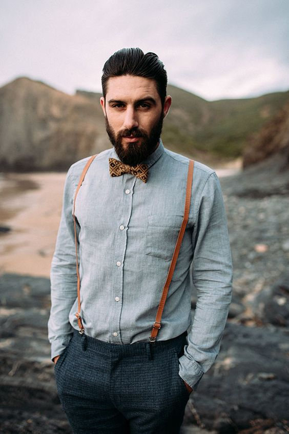 graphite grey pants, a chambray shirt, amber leather suspenders and a printed bow tie