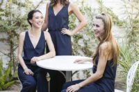 22 navy wide strap jumpsuits with black heels are a nice and elegant choice for the gals
