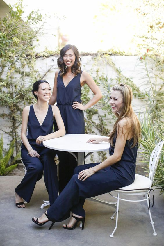 navy wide strap jumpsuits with black heels are a nice and elegant choice for the gals