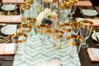 23 a chevron mint table runner, peachy napkins and gold flatware and gold rimmer glasses