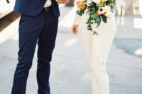 23 a creamy bridal pantsuit, a black bra and black heels for a chic and catchy modern look