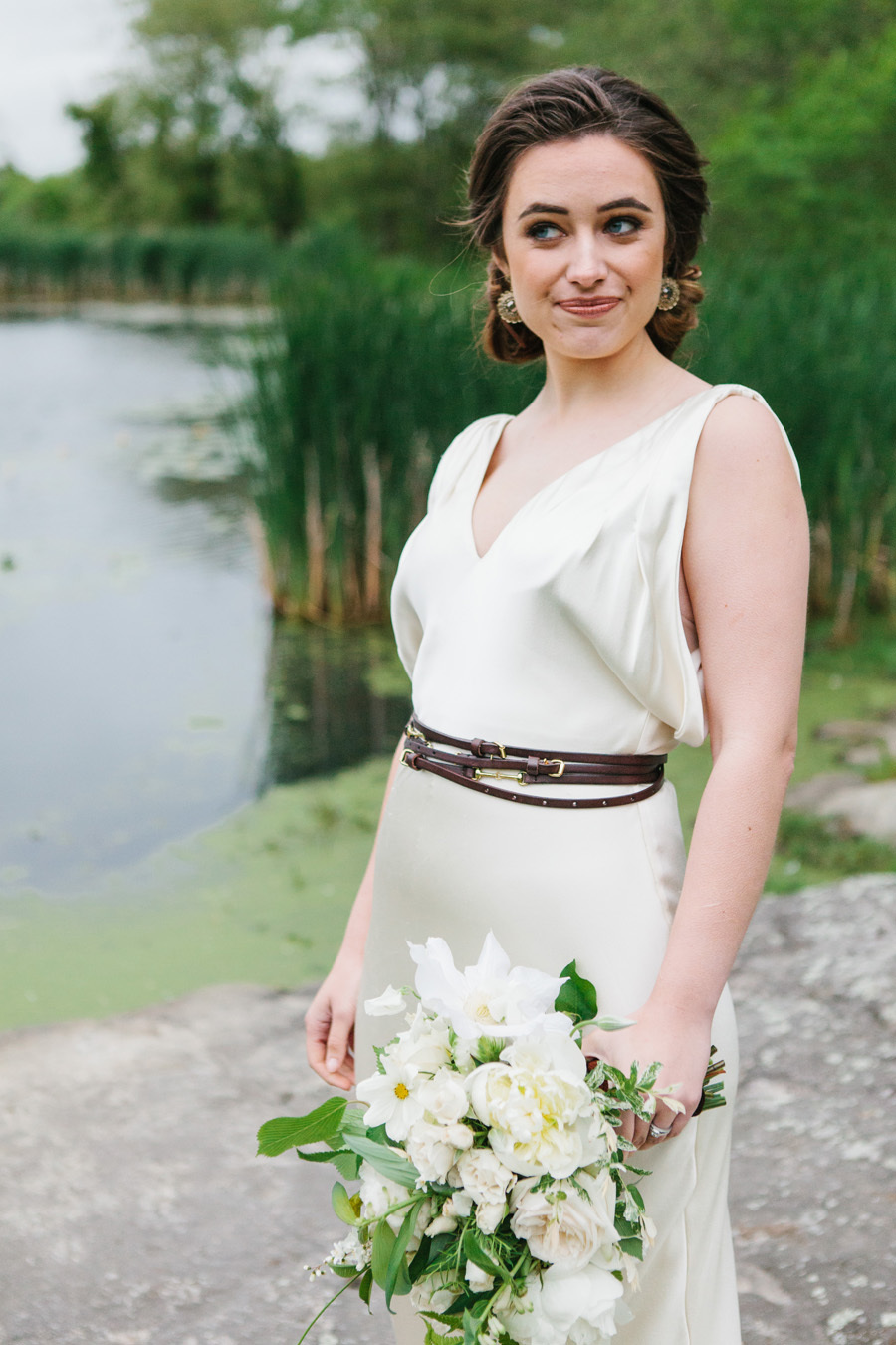 add a trendy and unusual touch to your bbridal look with a thin brown belt wrapped several times around the waist