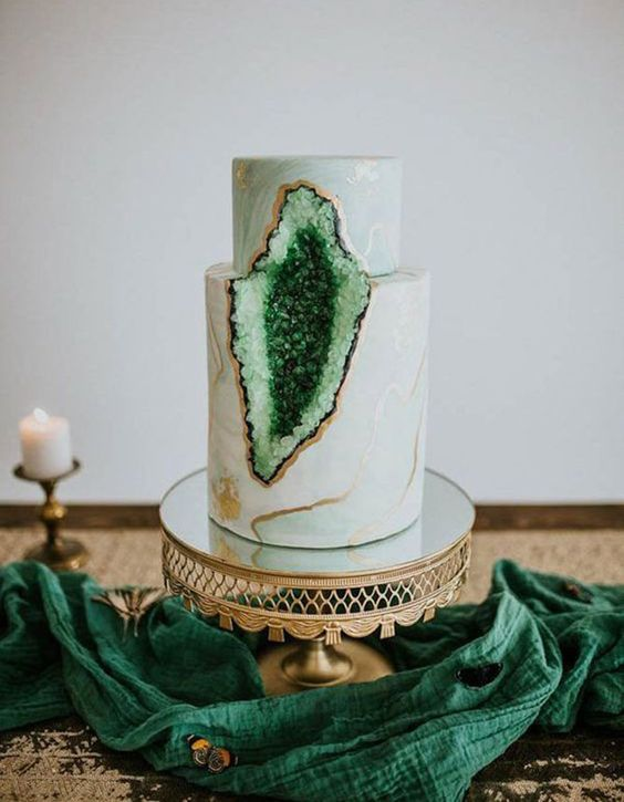 a gorgeous marble wedding cake with copper leaf and emerald geode for a trendy wedding