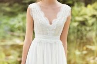 24 a very romantic vintage-inspired wedding dress with thick straps and a lace bodice and straps plus a flowy skirt