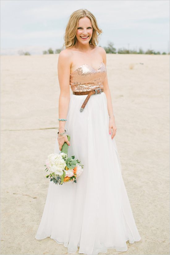 a wedding dress with a flowy skirt, a sequin strapless bodice and a brown leather belt to make a statement