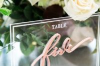 24 acrylic decor is very popular and is great for modern wedding decor like here – an acrylic table number