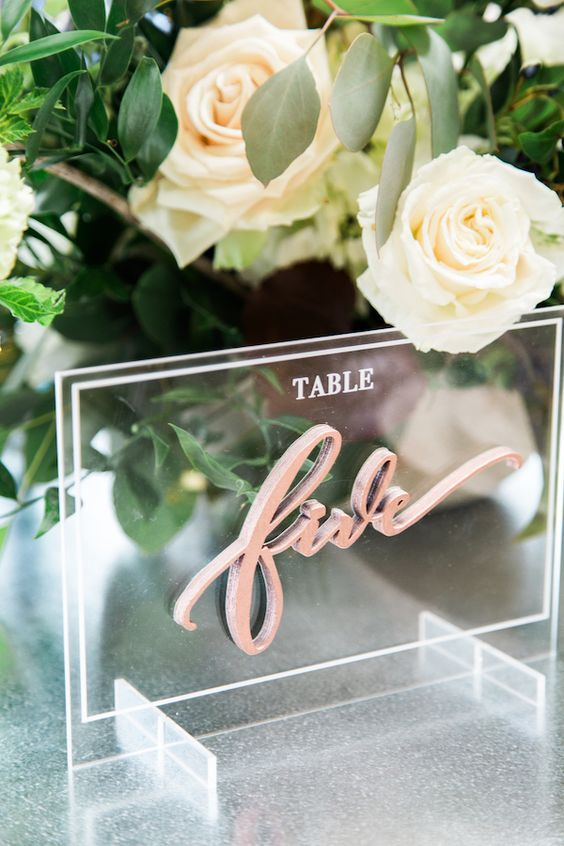acrylic decor is very popular and is great for modern wedding decor like here - an acrylic table number