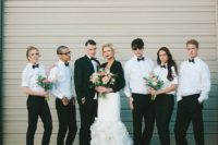 24 black pants, white shirts and black bow ties for both groomsmen and bridesmaids and a modern look