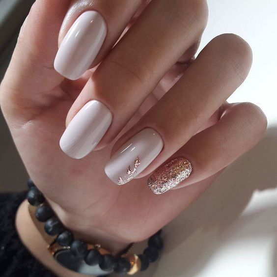 creamy nails with rose gold accents here and there is a very feminine option to go for
