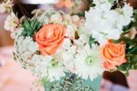 25 a mint-colored vintage pot with whiote and peachy blooms and a texture