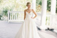 25 an A-line wedding gown with a lacey bodice, a full skirt and a statement necklace to fit the neckline