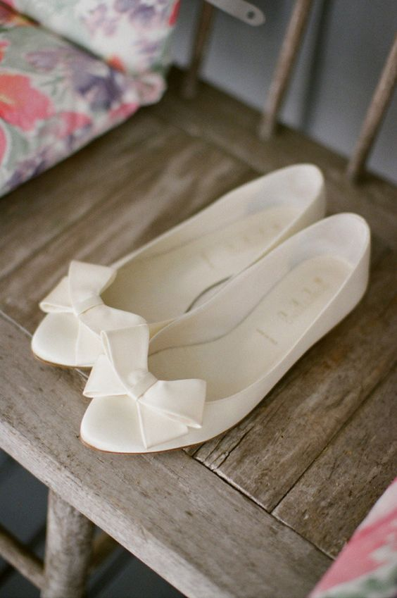 classic creamy flats with large bows are perfect for many bridal styles