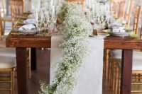 26 a baby's breath table runner over a neutral fabric one is a grea option for a rustic wedding