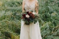 26 an eye-catchy wedding dress with a semi sheer windowpane bodice, lace appliques and an asymmetrical skirt