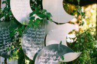26 metal crescent moon seating chart in the greenery is a cute idea to rock