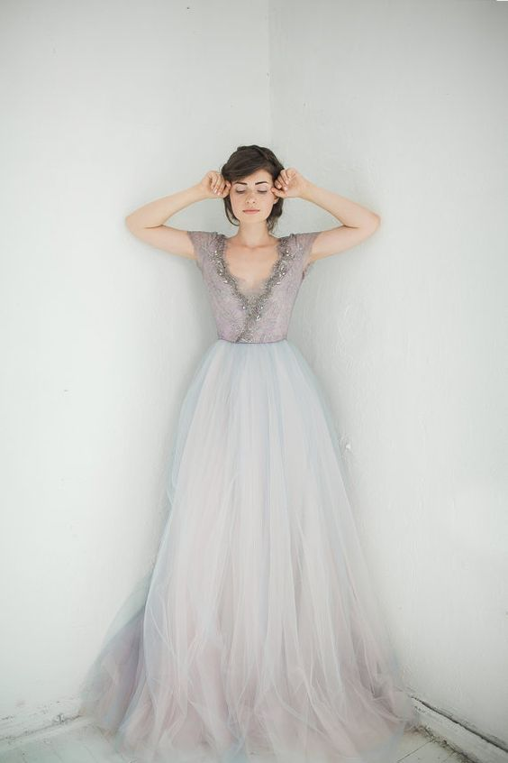 a subtle wedding dress with a lavender embellished bodice and a layered tull skirt with an ombre effect