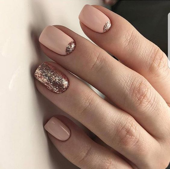 pink nails and rose gold accent half moons and an accent glitter nail for a gorgeous feminine feel