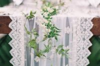 28 a gorgeous tulle and lace table runner with fresh greenery and white flowers in one for an airy look