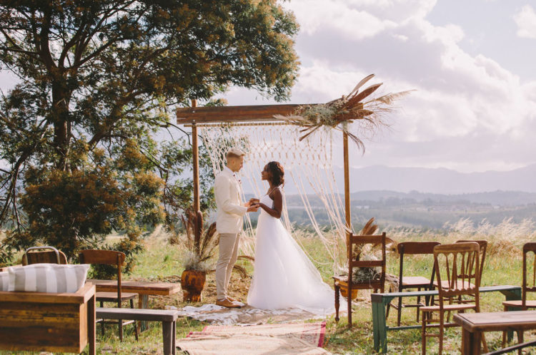 This boho chic glamping wedding shoot took place in Africa and was done with genuine African items and art