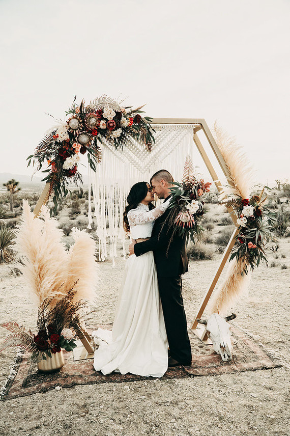 This gorgeous boho desert wedding shoot is full of trends and edgy details that you may steal for your own nuptials