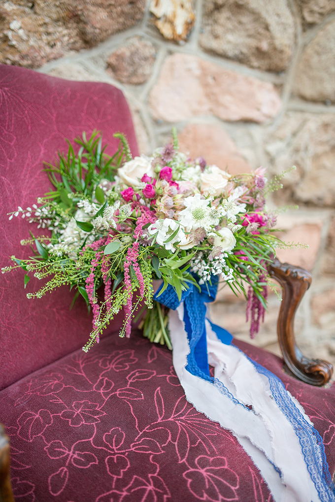 The bridal bouquet looked rather messy and featured a lot of textures thanks to greenery and colorful ribbons