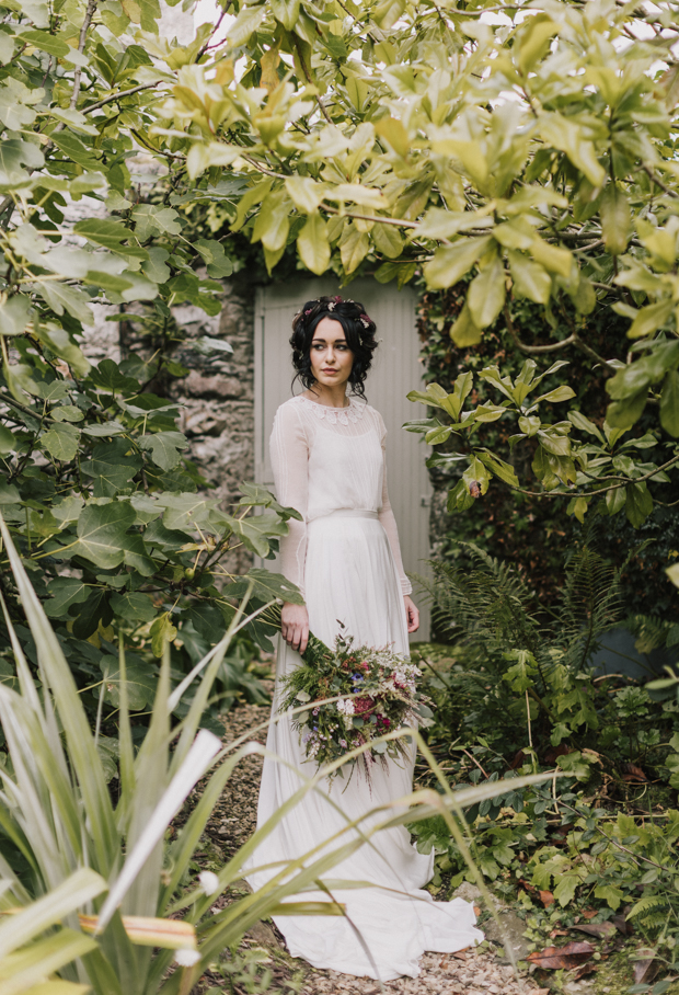 The bride was wearing a modest wedding dress with a sheer overdress, illusion sleeves and a lace trim