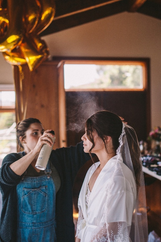 The bride was wearing a ponytail and a veil, a great idea for a modern wedding