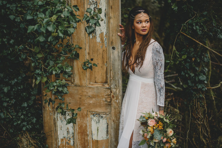 The bride was wearing a sexy lace wedding dress with a deep V-neckline and long sleeves