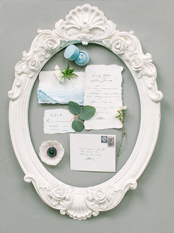 The wedding invitation suite was done in blue watercolors and have a look at this refined white frame