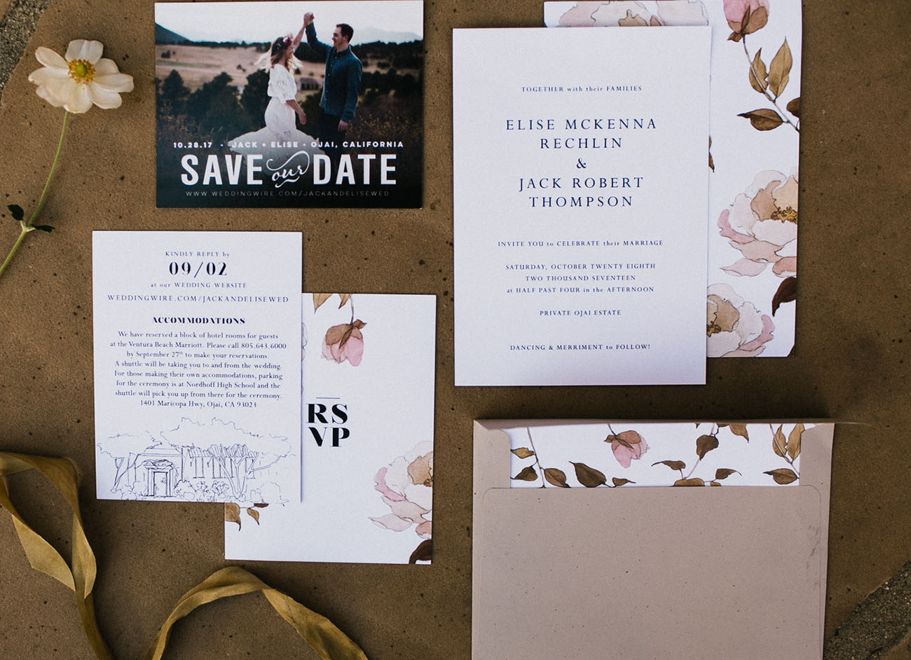 The wedding invitation suite was done with kraft paper and blush roses