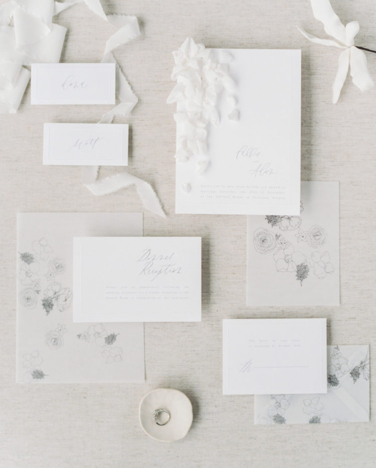 The wedding stationery set was done with calligraphy, airy petals attached to the invitations and some graphic blooms