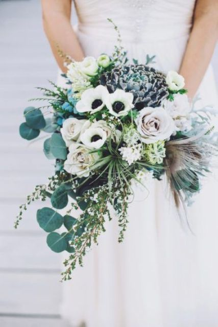 a cascading wedding bouquet with white anemones, pale roses, herbs and greenery