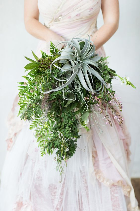 a chic cascading greenery wedding bouquet with a large air plant on top to stand out