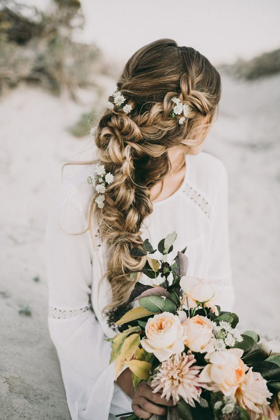 a very dimensional and textural braid made of two side ones with fresh flowers