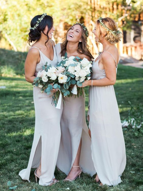 mismatching off white bridesmaids' dresses with side slits and spaghetti straps for an airy feel