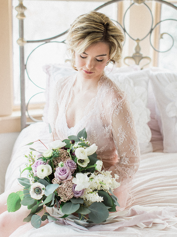 The bride was wearing a lace lingerie gown for the preparations