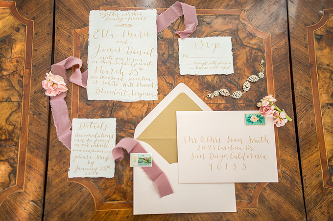 The wedding invitation suite was done in blush, with calligraphy and a raw edge