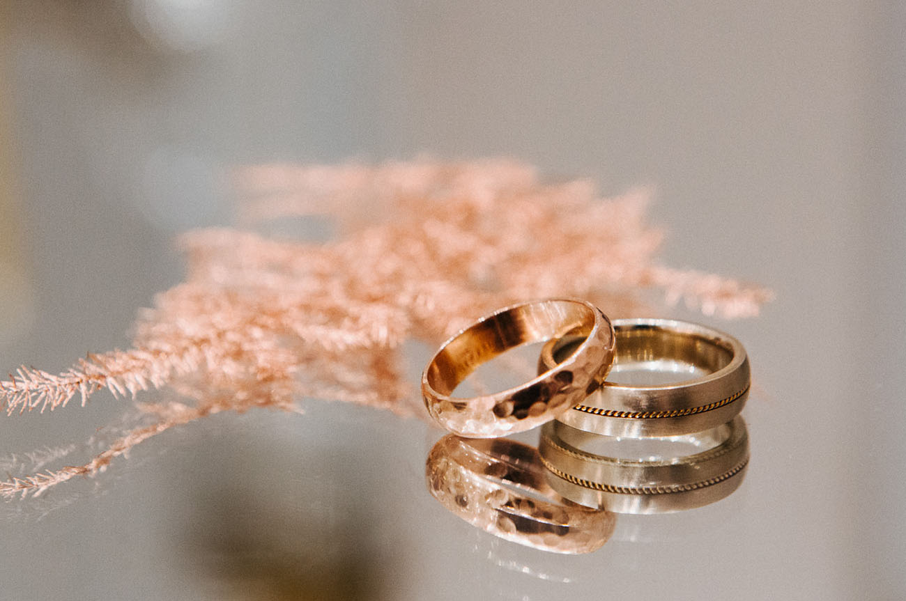 The wedding rings were a hammered and a thin rope one
