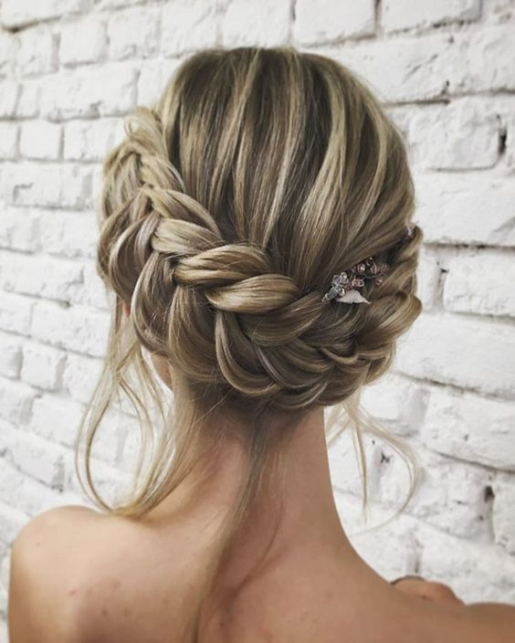 a braided updo with some locks down is ideal for a boho chic or just relaxed outfit