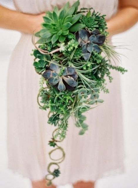 a cascading bouquet with greenery, succulents of various kinds and some vines for a unique look