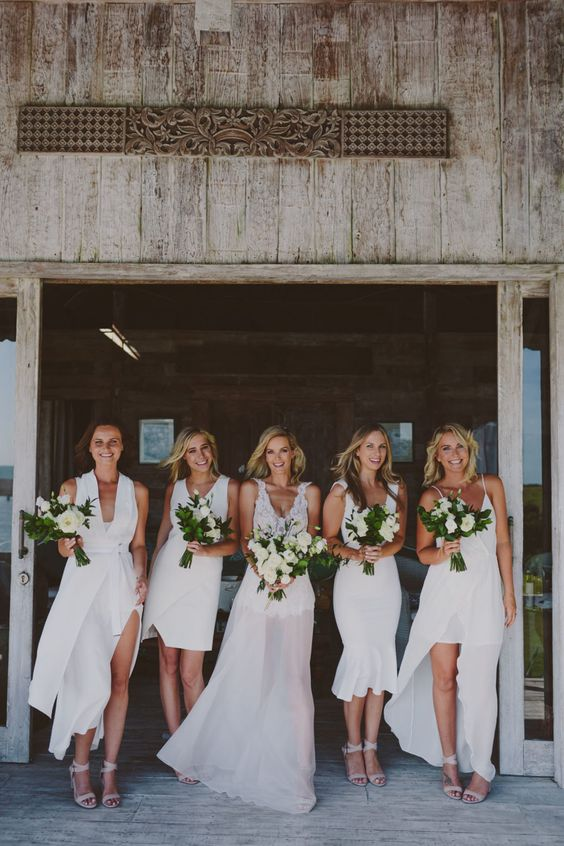 white bridesmaids' dresses   a high low with spaghetti straps, midi and mini with thick straps and a front slit one with thick straps