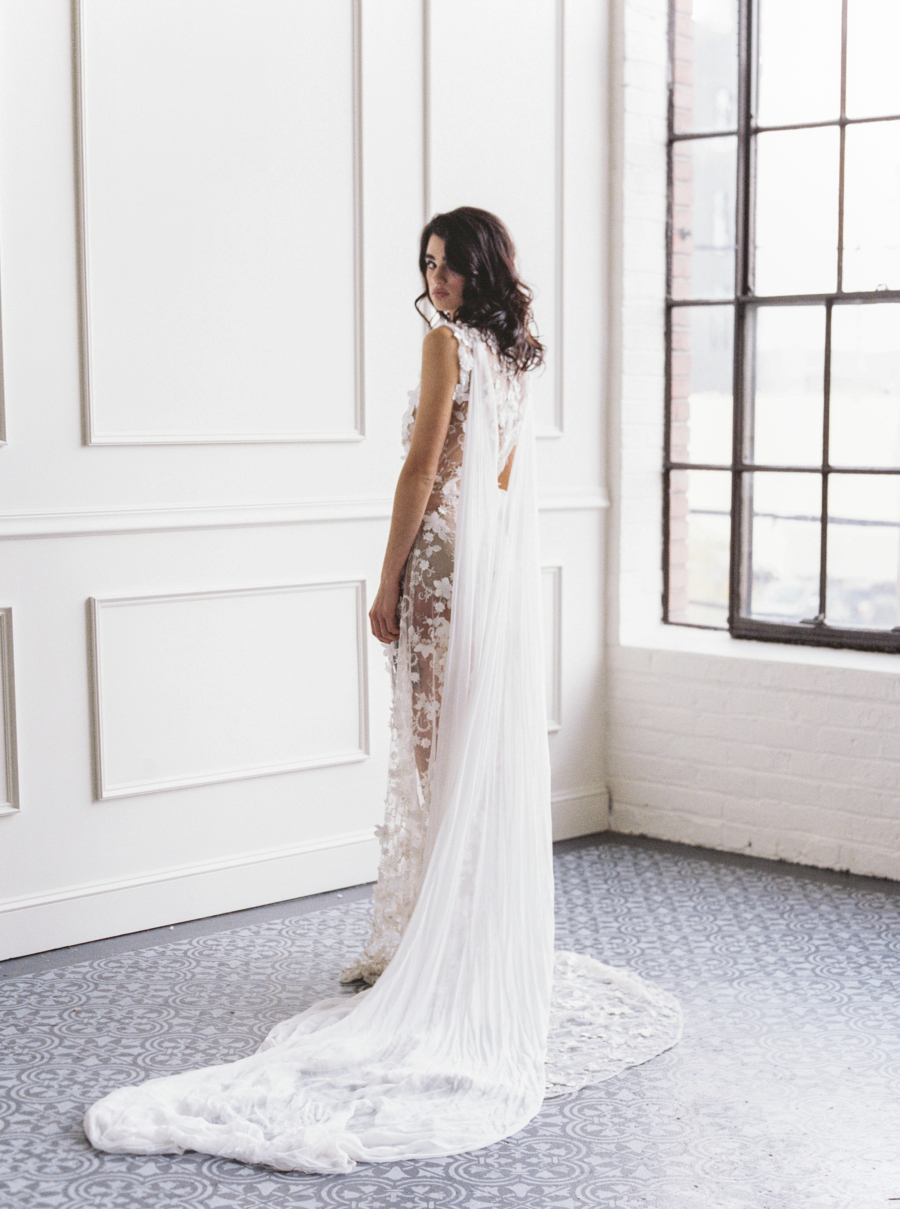 She was also wearing a cape, which is a hot bridal trend instead of a veil