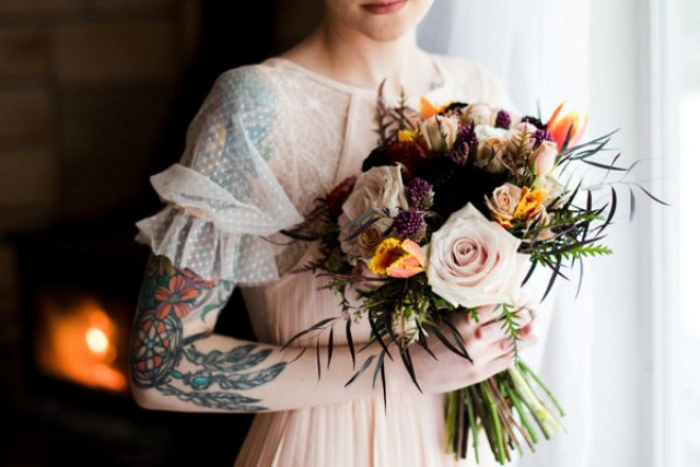 The bridal bouquet was done with blush, mustard, black and pink blooms plus textural herbs