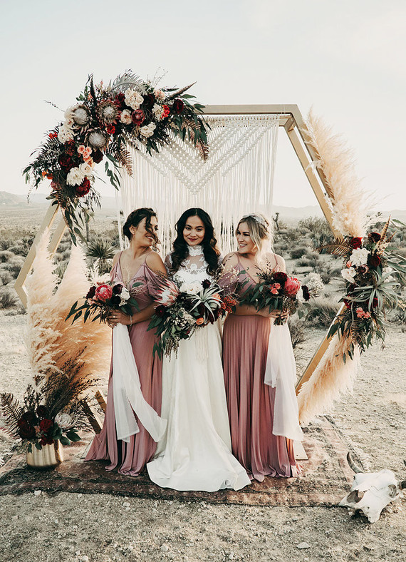 The bridesmaids were wearing dusty pink cold shoulder dresses and boho updos