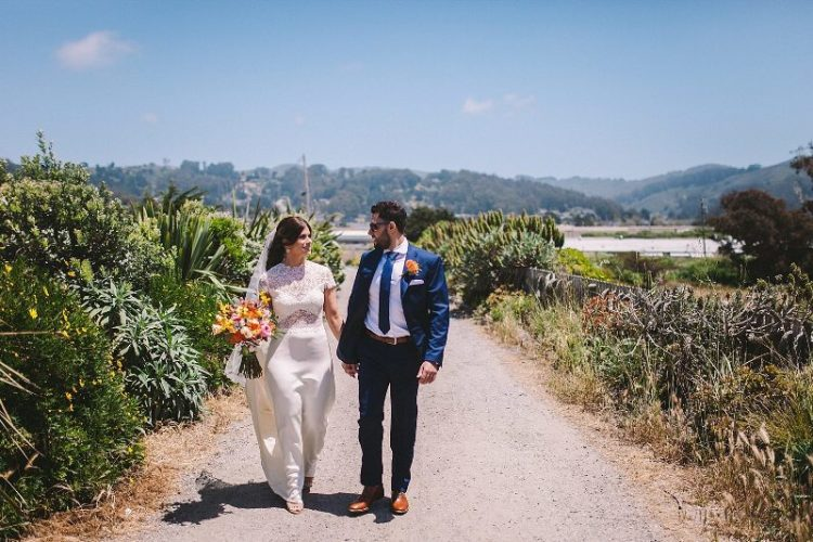 The groom was wearing a bold blue suit, a matching tie and amber shoes for a cool look