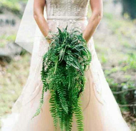 a cascading fern wedding bouquet is a bold idea for a tropical bride