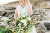 04 a cascading textural wedding bouquet with much greenery, herbs and some white blooms