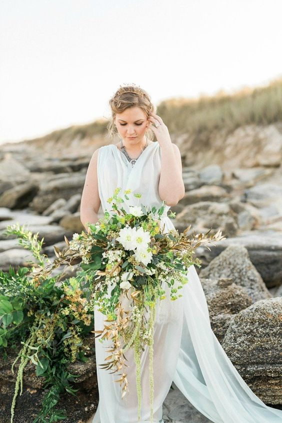 a cascading textural wedding bouquet with much greenery, herbs and some white blooms