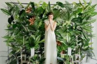 04 a green wall made of various tropical leaves and ferns for a tropical feel wherever you are