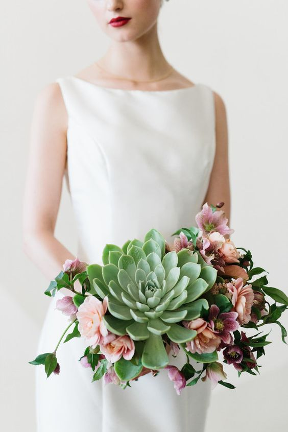 a modern wedding bouquet with an oversized green succulent, pink and fuchsia blooms